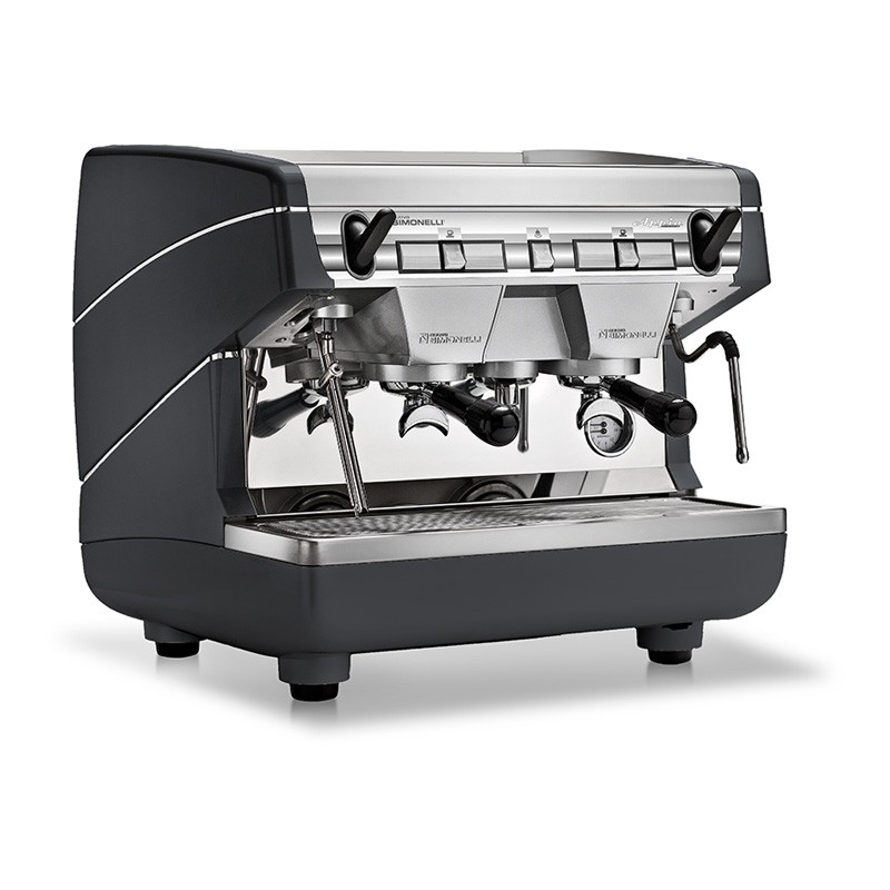Image is a front-side view of the Nuova Simonelli Appia II Compact 2 group espresso machine in Standard Black, with traditional brew group height and semi-automatic dosing controls.