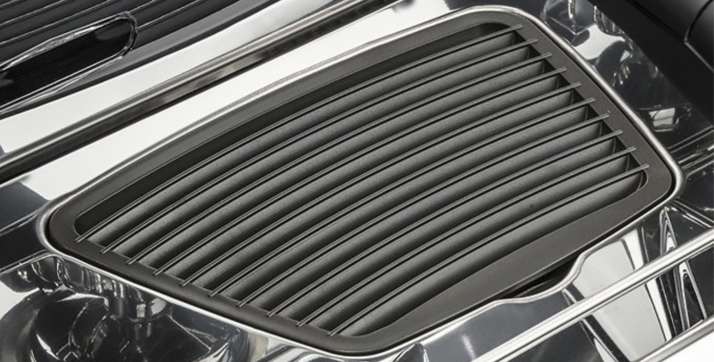 This is a closeup image of the dishwasher-safe drip tray on the Classe 5 espresso machine.