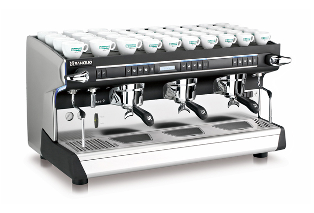 This image is a front-side view of the Rancilio Classe 9 USB espresso machine in 3 groups at traditional height with volumetric dosing.