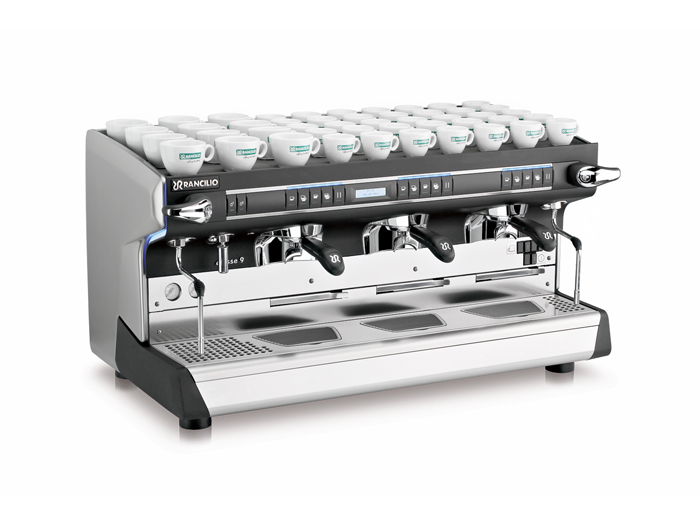 This image is a front-side view of the Rancilio Classe 9 USB tall espresso machine in 3 groups with a larger group area at traditional height with volumetric dosing controls.
