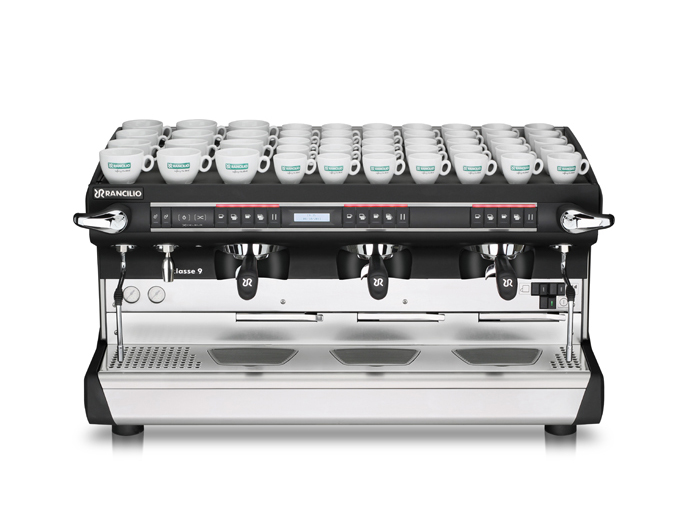 This image is a front view of the Rancilio Classe 9 Xcelsius tall, 3 groups with a taller group area and volumetric dosing controls.