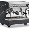 Image is a front-side view of the Nuova Simonelli Appia II Compact 2 group espresso machine in Standard Black, with traditional brew group height and volumetric dosing controls.