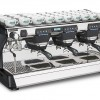 This image is a front-side view of the Rancilio Classe 7 3 group espresso machine in Anthracite Black, with traditional brew group height and USB volumetric dosing controls.